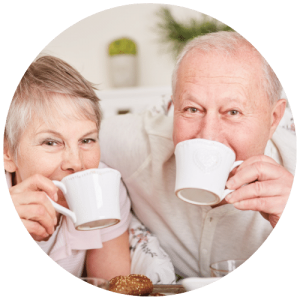 elderly couple drink beverage